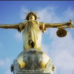 Image of Lady Justice balancing scales