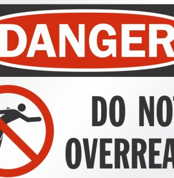 Image of a dafety sign saying 'Danger Do Not Overreach'